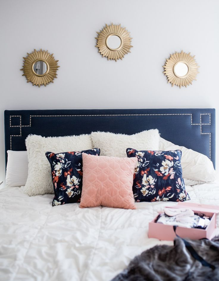 gold mirrors, bedroom decor, floral pillows