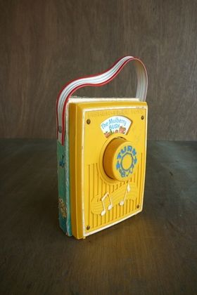 Man, I have a great memory! I had one of these when I was a toddler and I carried it around by the little strap EVERYWHERE! It played nursery rhyme songs. Do kids even KNOW what nursery rhymes are anymore?