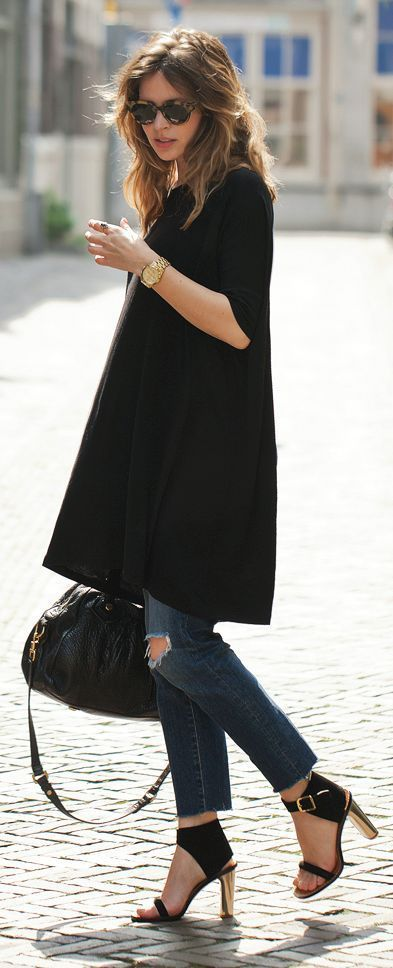 The little black dress in a tunic. Worn over jeans. Chic and hip come together via Brit+Co.