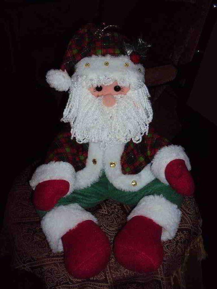 Papa noel y mono de nieve sentados