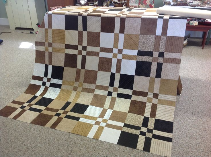 I made this quilt using two layer cakes from Primitive Gatherings, by Moda. This is a dissappearing  four patch. Makes a nice masculine quilt!