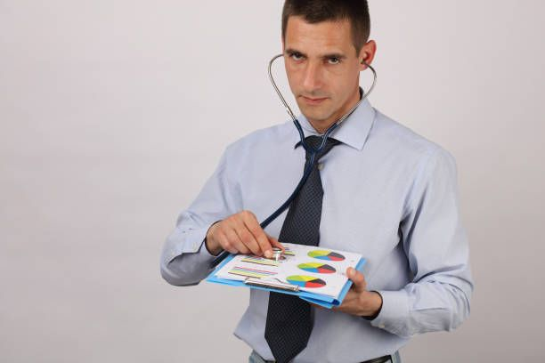 businessman with stetoscope analysing the marketing environment and
