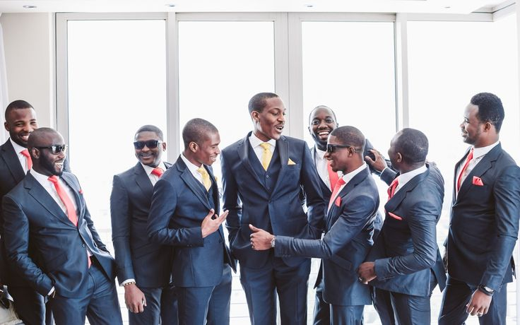 Grooms & Groomsmen. Nigerian and African groomsmen and groom. Navy suit with coral or yellow ties. Fun groomsmen photography. Image by Kristi Agier