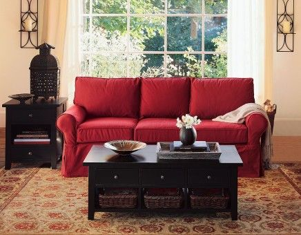 Red couch living room decorated with home decor items make it Adorable!