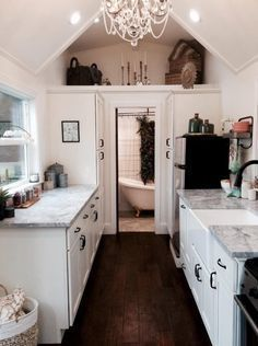 Rustic Chic Tiny House by Tiny Heirloom. Almost exactly the layout I want in my home though I'd be using a larger gooseneck trailer. Really love the airplant wall over the soaking tub!
