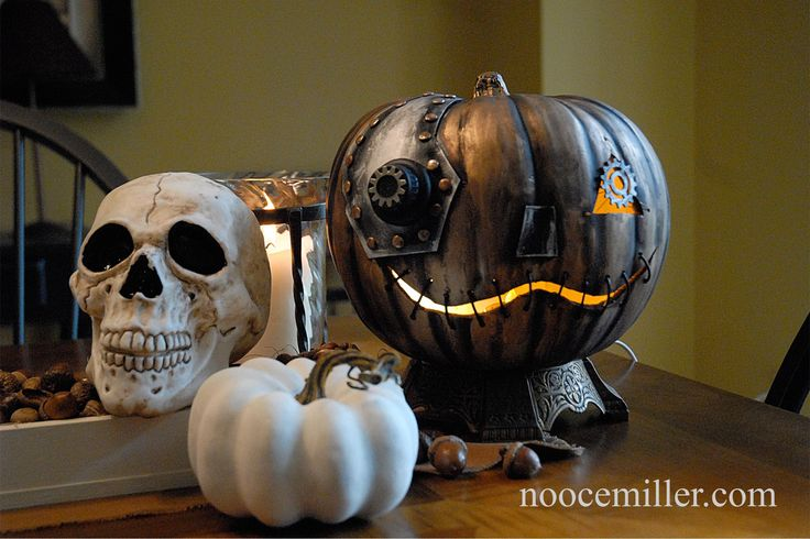 I just couldn't let you guys miss out on this easy to do Halloween DIY. When I came across it, it got me wayyy too excited. I found this on an author named Nooce Miller's website: http://www.noocemiller.com/?p=491. Be sure to give that a look when you get a chance! I have curated the DIY here for you. Things you need for this DIY: Foam Pumpkin Black Spray Paint Black Acrylic Paint Rub N Buff (Spanish Copper, Antique Gold, Silver) Black Foam Sheet Scissors, Ruler and Pencil Paper Pattern Glue…