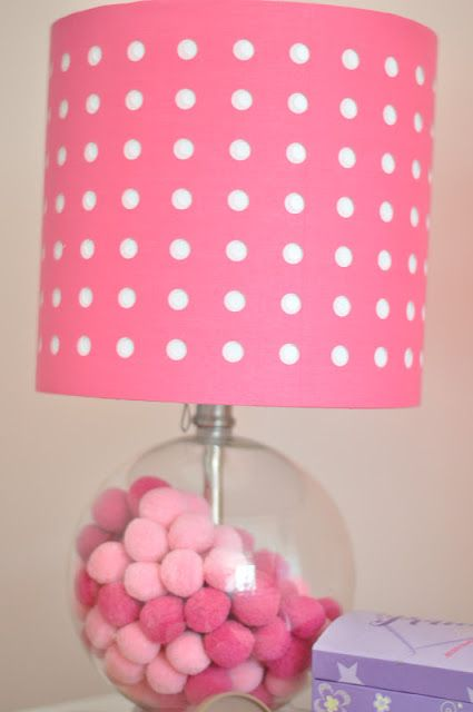Pom Poms in a clear lamp base....awesome for a little girls room!