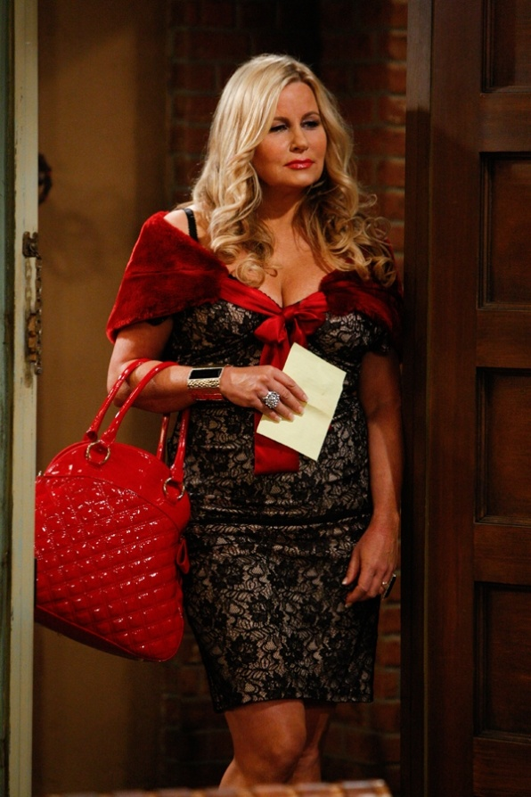 Upstairs Neighbor And the Upstairs Neighbor -- Max and Caroline are suspicious of the new upstairs neighbor who moves in after the old tenant dies, on 2 BROKE GIRLS. Jennifer Coolidge, shown, guest stars as Sophie, the upstairs neighbor. Photo: Sonja Flemming/CBS © 2011 CBS Broadcasting, Inc. All Rights Reserved.