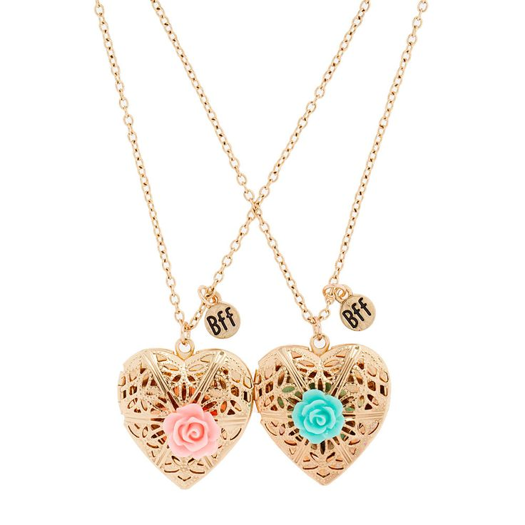 """<P>Show off friendship and style. These ornate gold heart lockets both adorned with a pastel rose are a great way to match your BFF. Includes 1 green and 1 pink.</P><UL><LI>Chain: 19 1/2""""L<LI>Pendant: 1""""L x 1""""H<LI>Lobster clasp closure<LI>Materials: Metal</LI></UL>"""