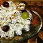 Green Grape Salad    Ingredients:  4 pounds seedless green grapes  1 (8 ounce) package cream cheese  1 (8 ounce) container sour cream  1/2 cup white sugar  1 teaspoon vanilla extract  4 ounces chopped pecans  2 tablespoons brown sugar   Directions:  1.Wash and dry grapes. In a large bowl, mix together the cream cheese, sour cream, sugar and vanilla. Add grapes and mix until evenly incorporated. Sprinkle with brown sugar and pecans, mix again and refrigerate until serving.