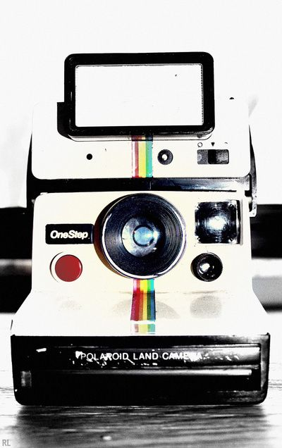 Polaroid instant camera. I had one of these as a kid, my Grandparents loved all the weird pictures I would take. I think they just humored me. =]