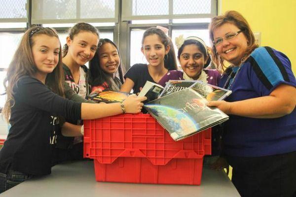A New York City school teacher and students, part of the MyLibraryNYC program