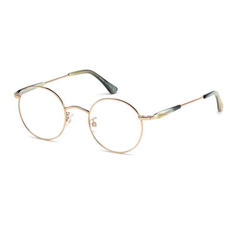 Tom Ford FT5344 028. Occhiale da vista Tom Ford ideale sia per l'uomo che per la donna. Montatura in metallo color oro e rifiniture in celluloide con frontale tondeggiante estremamente particolare stile vintage.