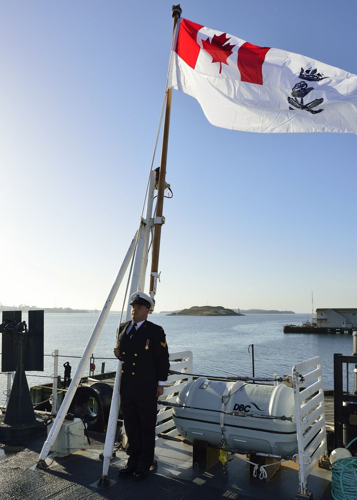 Leading Seaman Marcus Hibbert stands at attention after raising the new ensign onboard Her Majesty's Canadian Ship Halifax during the colours ceremony held on May 5, 2013 in Halifax, Nova Scotia. Photo: Leading Seaman Ronnie Kinnie, Formation Imaging Services, Halifax, Nova Scotia