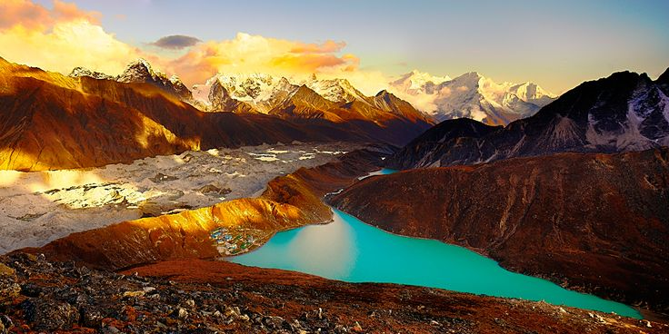 Sunset over the Gokyo Lakes from the summit of Gokyo Ri, in Nepal's Sagarmatha National Park, with Thamserku rising in the background. Snowfalls in the Cho La and other passes are visible in the distance.