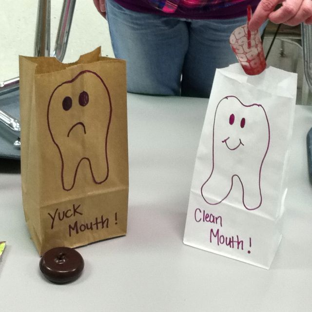 Yuck mouth brown bag and clean mouth white bag. Kiddos place play food or pics in correct bag