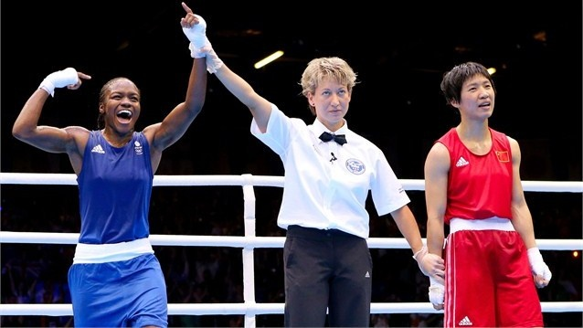 Referee Veronika Szucs (C) announces Nicola Adams (L) of Great Britain winner against Cancan Ren (R) of China during the Women's Fly (51kg) Boxing final bout on Day 13.