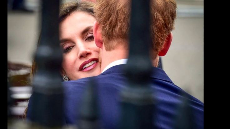Queen Letizia charmed by Prince Harry as he leans in to kiss her