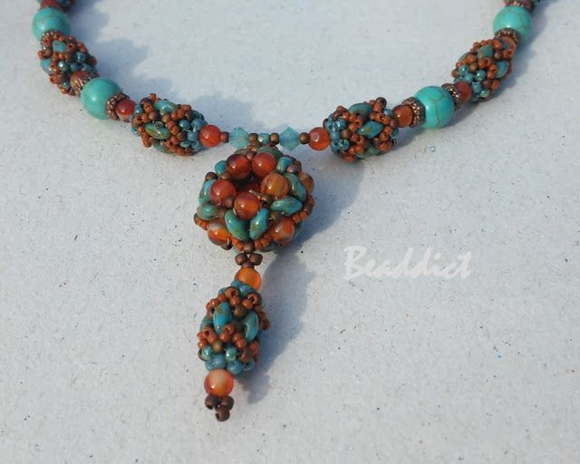 """""""Sanaz"""" necklace. Pattern by Un- Roen Manarata. Beaded by Beaddict.  Seed beads, karneol and turquonite stone beads, copper wire, bead weaving."""
