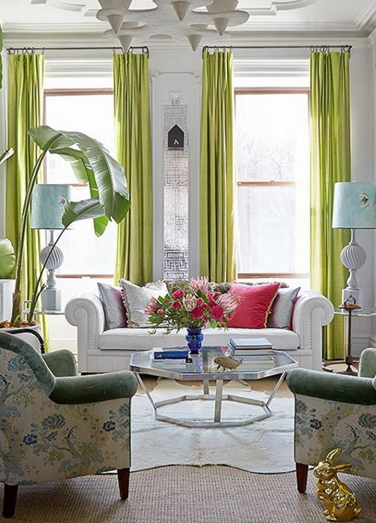 Lime green floor to ceiling curtains pair beautifully with all-white furniture and hot pink accents.
