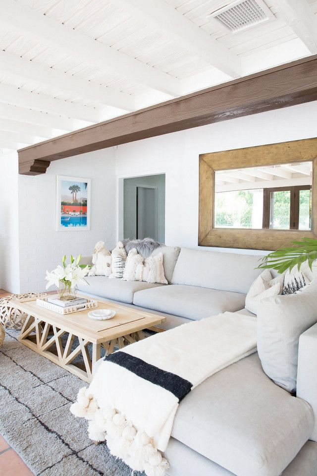 """On the family room: """"This room was intended to function as an informal living space. The couple has 4-year-old twin boys, so while they are incredibly well behaved it was important for the space..."""