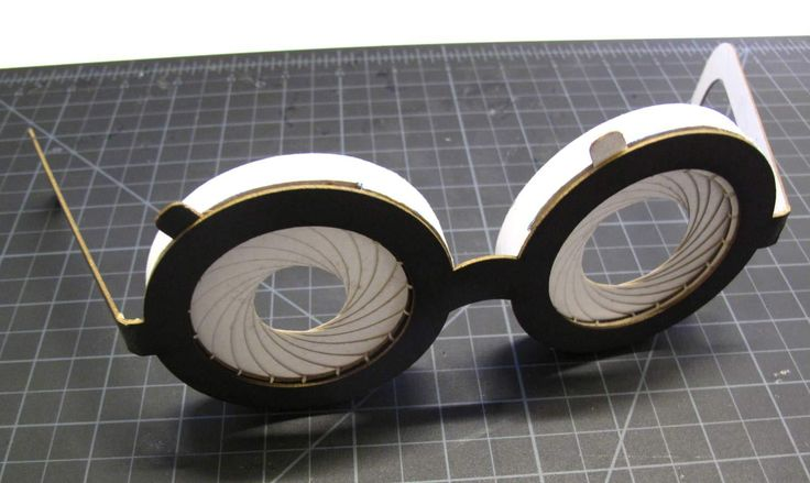 Iris mechanism glasses out of paper and string. The above video was made in Autodesk Inventor publisher, and the model was made in Autodesk Inventor. The attached PDFs are for 11x17 printing, outline of pieces are included to cut out with dimension to scale. If you have access to a laser cutter there is a dxf ver attached as well. Time: 3-6 hours Get your geek on. Materials: Ruler xacto knife paper glue (i used soba brand) string - thats thin and strong ( i used book bindin...