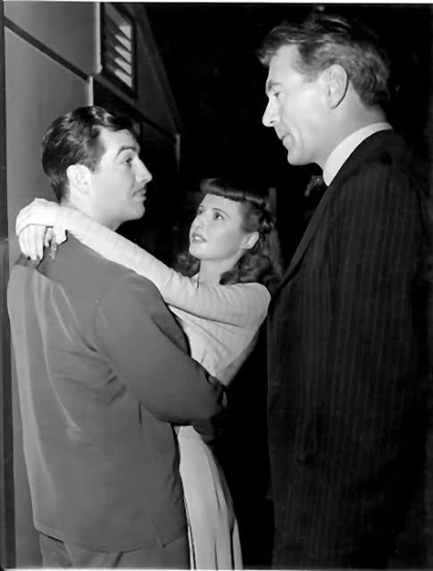 "Barbara Stanwyck with Robert Taylor and Gary Cooper.  Better known as the one she had...and the one she SHOULD'VE had! On the set of ""Ball of Fire"" c. 1941"