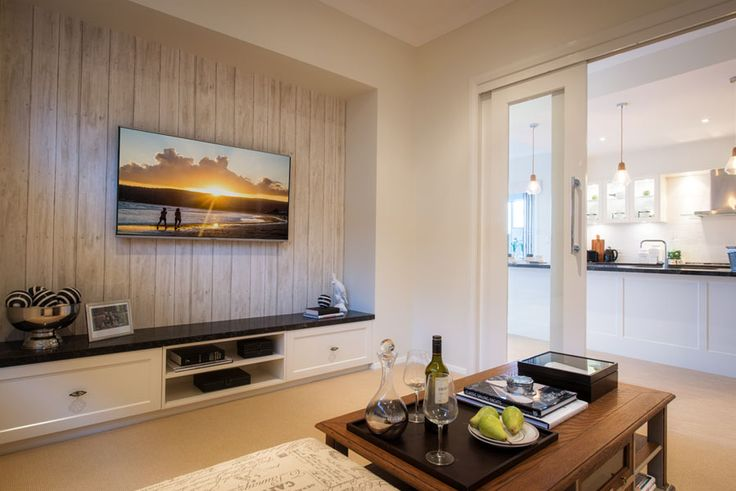 Beautiful feature wall and #Hamptons styling in the Milano Four 15m on display in Shell Cove. For details see http://mcdonaldjoneshomes.com.au/display-home-locations/shell-cove #living #hometheatre #lounge #coffeetable #table #featurewall #timber #natural #raw #coastal #seaside #beachhouse #beach #style #interiordesign #home #newhome #cabinetry #carpet #decorate #accessories #decorations