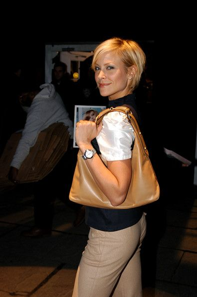 Brittany Daniel Photos - Actress Brittany Daniel poses in the lobby during Olympus Fashion Week at Bryant Park February 11, 2004 in New York City. - Olympus Fashion Week - Bryant Park