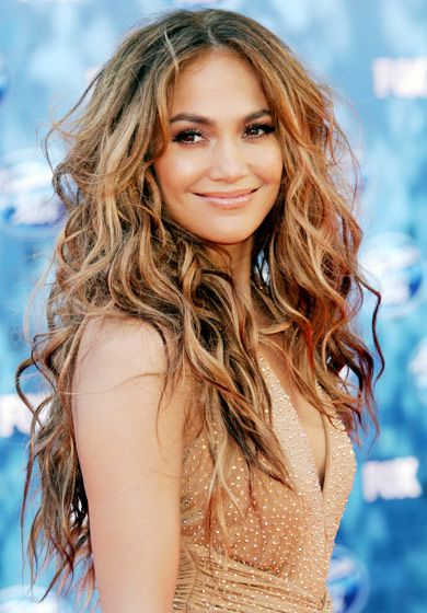 """During the American Idol season 10 live grand finale, the """"Dance Again"""" singer sported a voluminous mane of curls in L.A. on May 25, 2011."""