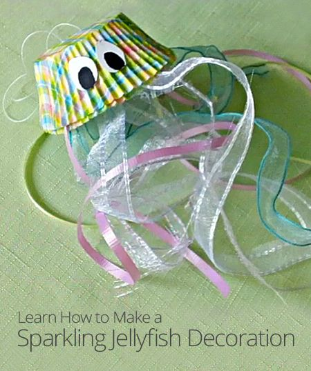 DIY Sparkling Jellyfish Decoration. Super cute craft for an Under the Sea or beach theme party. Cupcake liners and ribbon, could also add google eyes.