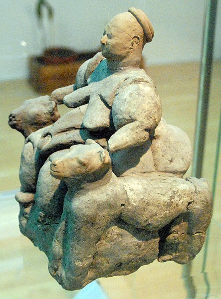 Side view of the mother goddess figurine in Catal Huyuk. Catal Huyuk the Turkish name for a Neolithic archaeological site in Turkey.