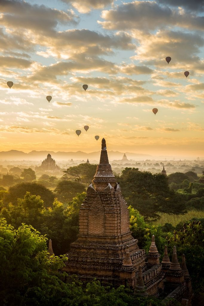 Myanmar's dreaming temple spires feature in this inspiring sunrise © tapshanov