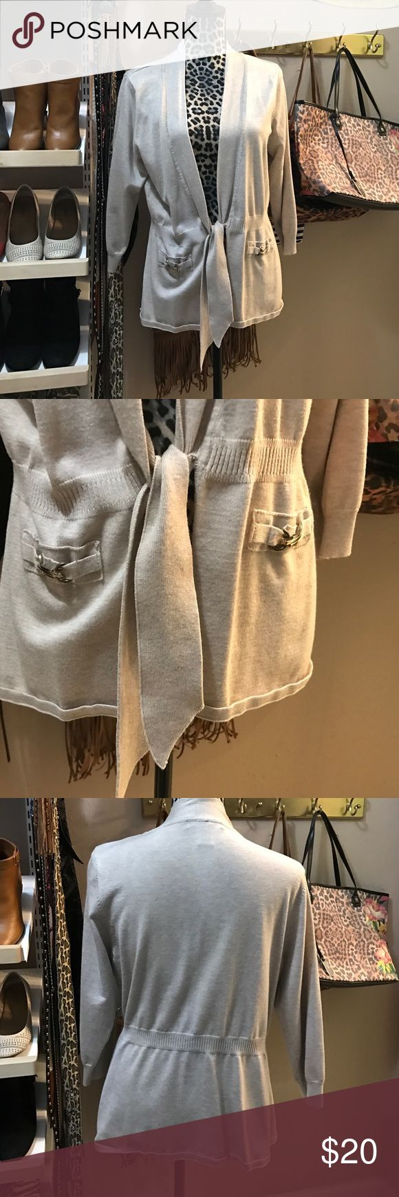 Beige tie front cardigan. Like new worn a few times. Beige cardigan that ties in the front with two pocket and gold hardware. Been in storage so needs a good iron! Grace Elements Sweaters Cardigans