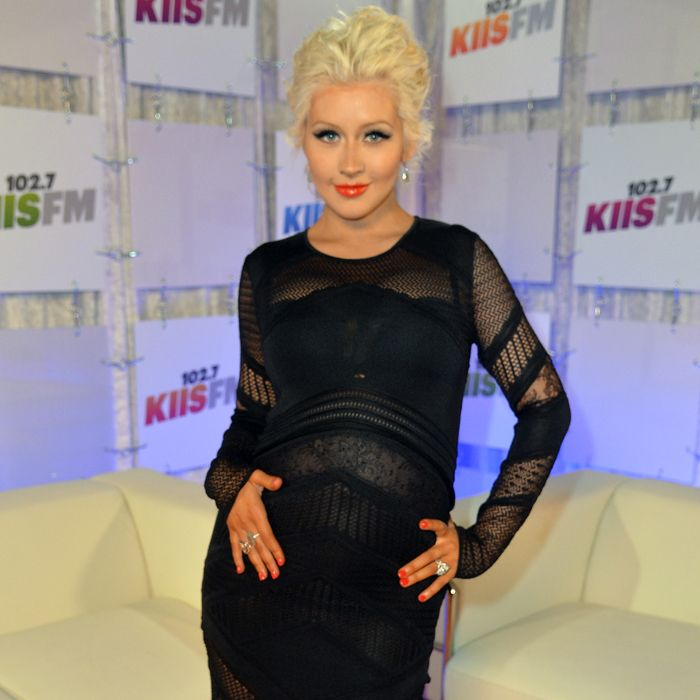Check out Christina Aguilera's racy third-trimester photo shoot, and tell us what you think!