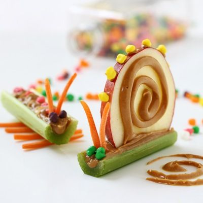With a knife, level the bottom of the celery (middle center) so that it is flat, not round. Fill with peanut butter. Use what you have on hand: apples, raisins, carrots, nuts, etc. Have the kids help create them to make snacking more fun.