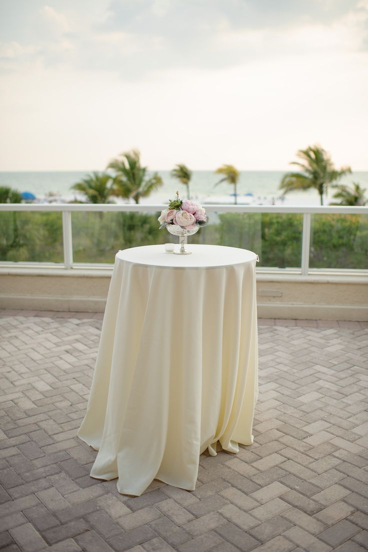 Cocktail high top table with ivory linen floral for Cocktail tables high