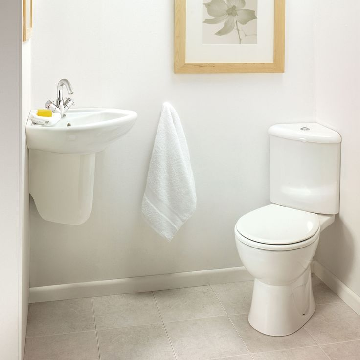 Corner sink, corner toilet for a small powder room