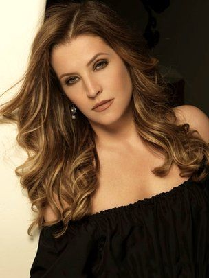 Elvis Presley's daughter, Lisa Marie Presley She looks more like Priscilla here.