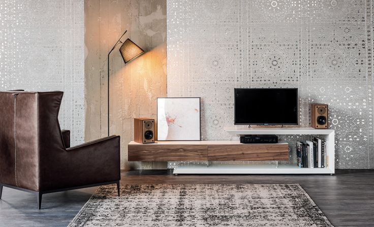 The LINK TV cabinet designed by Cattelan Italia is reversible and adjustable in width. It is the ideal piece of furniture to hold and hide TV accessories.
