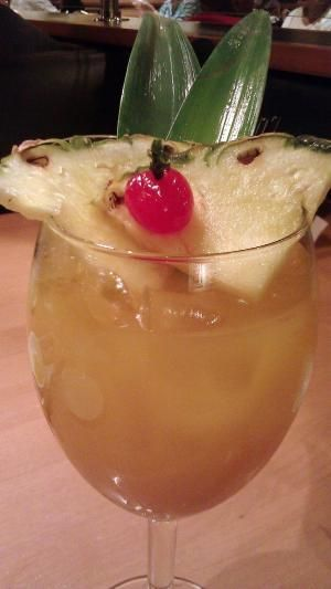 Caribbean Sangria - *3 cups of pineapple juice *1 cups of natural orange juice * ½ bottle of white wine preferably Riesling (can use Moscato if desired) *Malibu Rum (coconut rum) *Ice cubes *Fresh pineapple slices, maraschino cherries and pineapple leaves for decorating. by Joao.Almeida.d.Eca