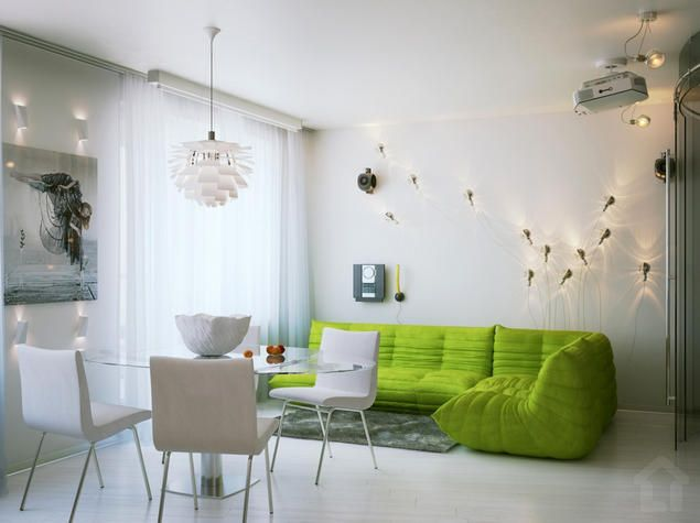Open plan living room with a nice, fresh green couch and original lighting.