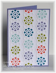 create a beautiful geometric design using the lace ribbon border and circle punches