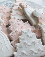 Deliziosi e bellissimi biscotti nozze doccia caratterizzano abiti da sposa, abiti da damigella d'onore e torte nuziali.