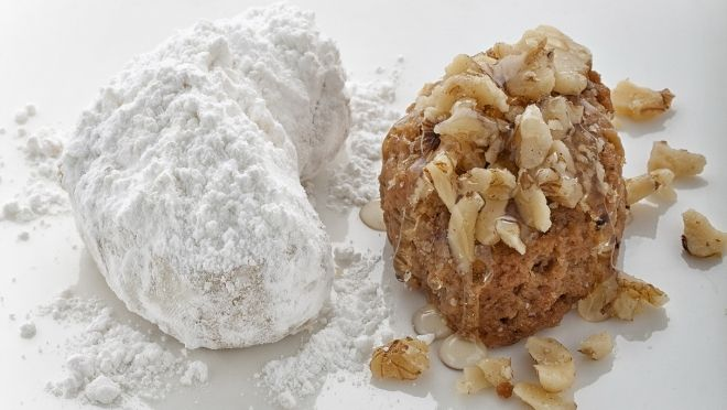 Kourabiedes & Melomakarona are traditional Greek cookies made during the Christmas holiday season.