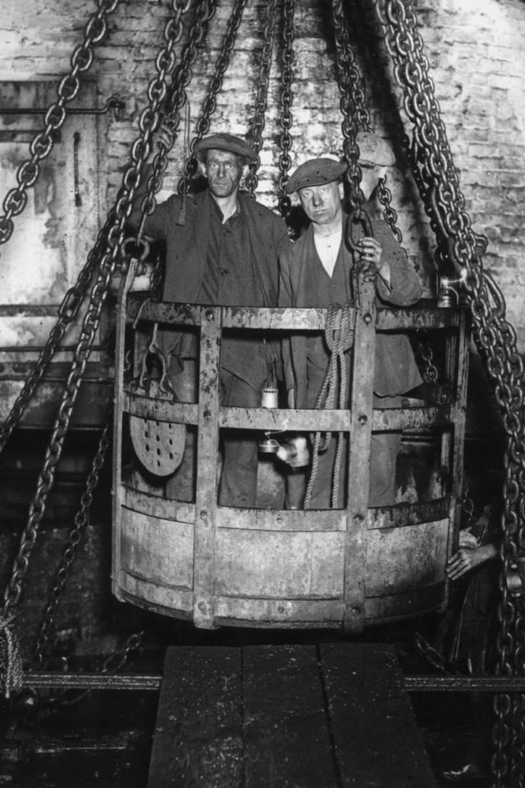 Coal miners in mine cage.