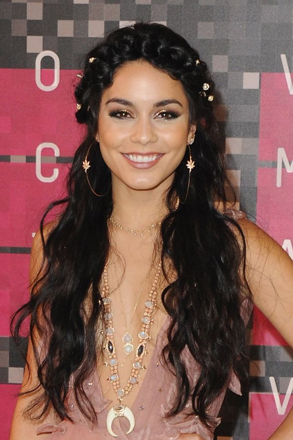 Vanessa Hudgens leaned in to her usual haute hippie look at the VMAs. She adorned her half-crown braid with tiny silver flowers (to match her pot-leaf earrings) and left the rest of her hair loose. She added a touch of red carpet glamour to her look with sparkling gold eyeshadow