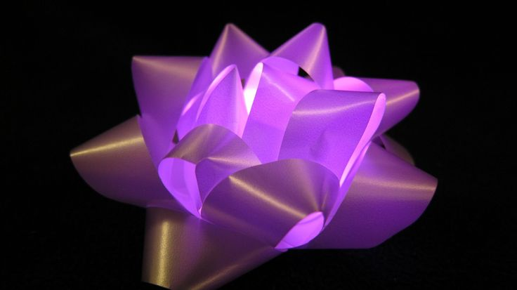 How to Make a Glowing Gift Bow that Changes Color! Use an LED Finger Ring http://glowproducts.com/batteryoperated/rainbowring/