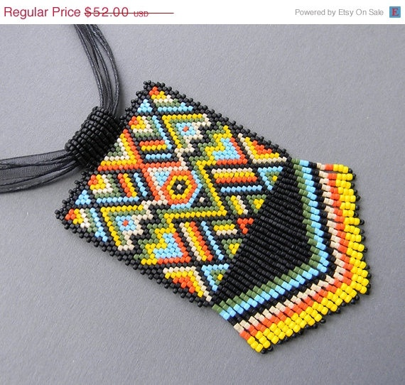 20% Off SALE Multicolor Ethnic Style Beaded Pendant  - peyote necklace. $41.60, via Etsy.