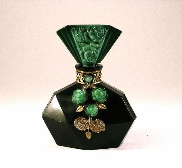 1930s Czechoslovakian perfume bottle in black glass with jeweled metalwork, malachite stopper with dauber. 4 3/8 in. Photo & description by Perfume Bottles auction